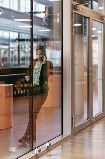 Woman standing by window