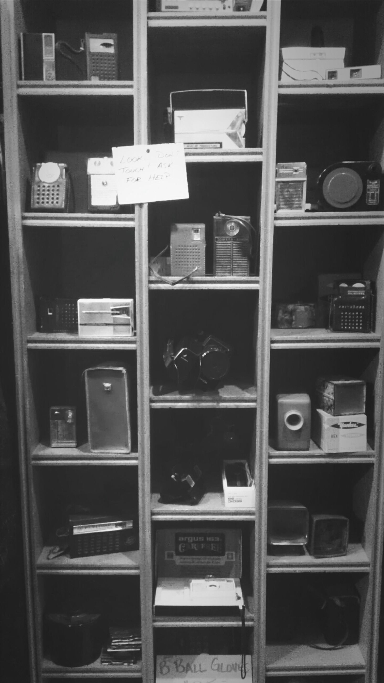 indoors, large group of objects, abundance, full frame, variation, order, in a row, shelf, arrangement, stack, backgrounds, choice, repetition, still life, collection, store, retail, no people, side by side, display