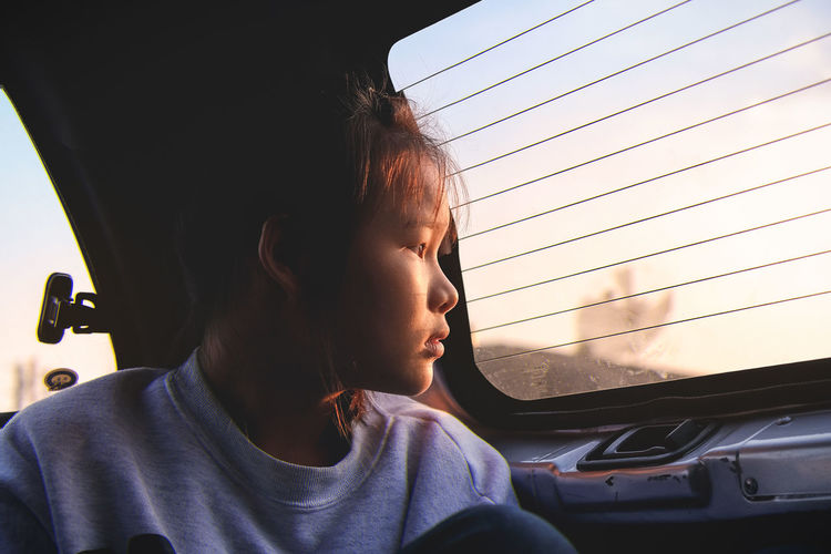 Girl Traveling In Car