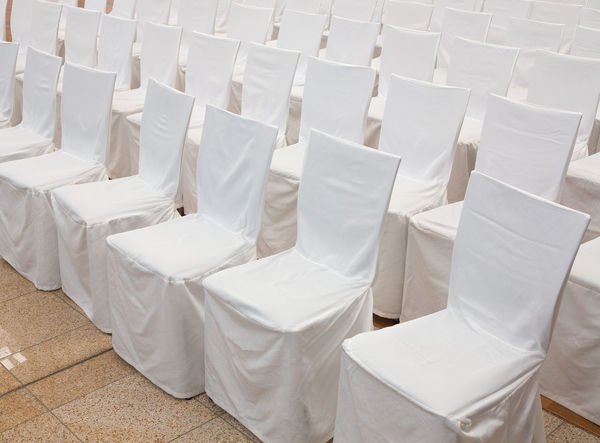 Row of chairs with white fabric covers Arrangement Audition Background Banquet Celebration Ceremony Chair Chairs Cloth Cover Covered Covers Day Decoration Event Fabric In A Row No People Party Reception Seat Textile Wedding White