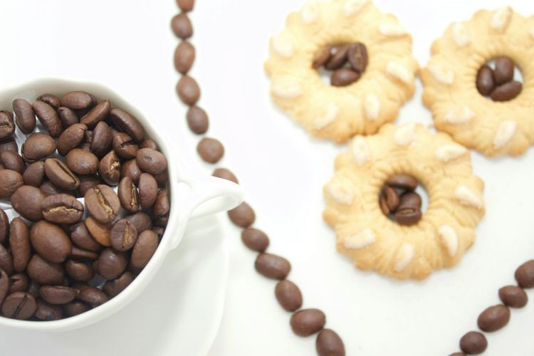 High angle view of coffee beans in cup on table
