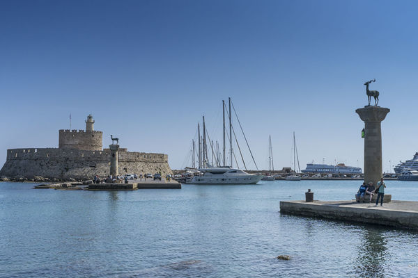 Entrance to Mandraki Harbour, Rhodes, Greece, with the Rhodes deer showing where the Colossus is alleged to have stood Harbor Harbour Mandraki Harbour Rhodes Greece Architecture Day Harbour Entrance Nautical Vessel Outdoors Sea Transportation Travel Destinations Water Waterfront