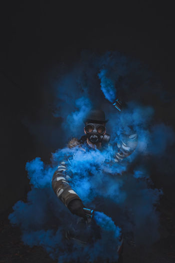 Smoke Gasmask EyeEmNewHere EyeEm Best Shots EyeEm Selects EyeEm Gallery Portrait portrait of a friend Portrait Photography Light And Shadow Shadows & Lights Sonyalpha Blue Smoke - Physical Structure Tones Mensfashion Men At Work  Exploding Firework Display Erupting Autumn Mood