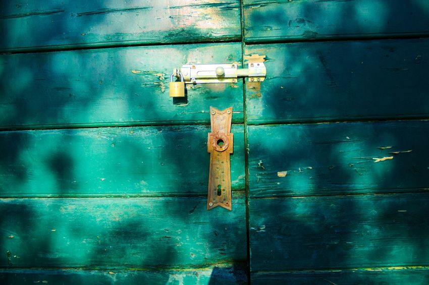 Rusty lock The Week On EyeEm Tranquility Blue Close-up Closed Day Door Hinge Latch Lock No People Outdoor Outdoors Protection Rusty Safety Security
