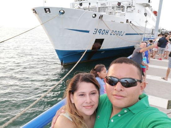 LogosHope Nautical Vessel Portrait Togetherness Sea Men Looking At Camera Headshot Water Smiling Women