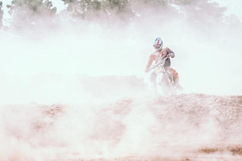 Man Riding Bike In Dirt