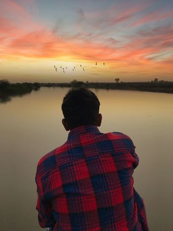 Sunset Sky Rear View Nature Real People Beauty In Nature Water Lake Reflection One Person Scenics Tranquility Lifestyles Outdoors Cloud - Sky Tranquil Scene Silhouette Men Leisure Activity One Animal