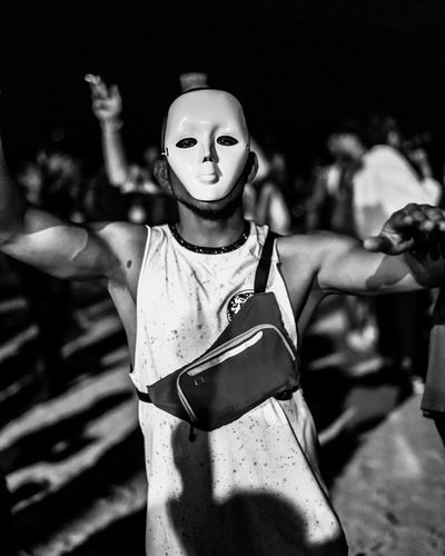 Masked Dancer Mask Costume Disguise Representation Front View Men Real People Waist Up Human Representation Focus On Foreground Masked Creepy Party Fancy Dress Scary Dancing Black & White Black And White Young Man Shoulder Bag Bag Beach Shadows White Face Muscular Build