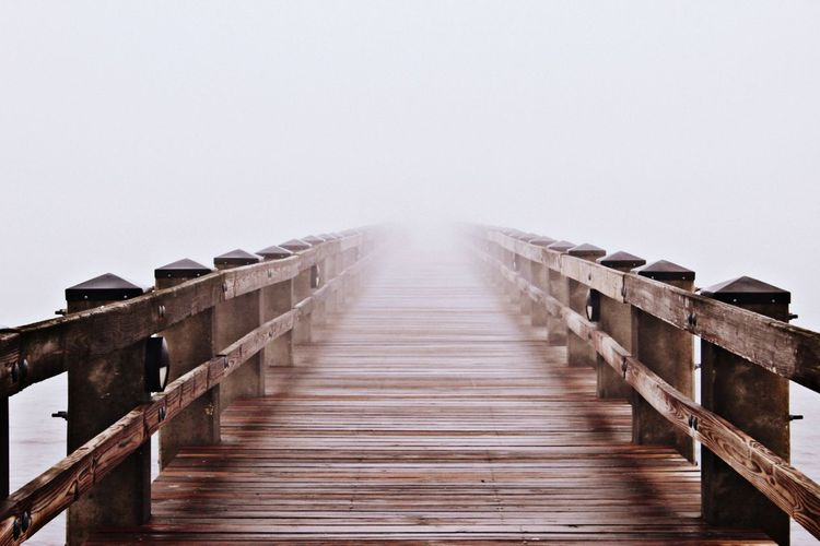 Into the Fog Ocean Up Close Beach Beachphotography Beach Life Fog Sea Winter Beach Wood - Material Railing Cold Temperature Water Sky Boardwalk Pier Foggy vanishing point My Best Photo