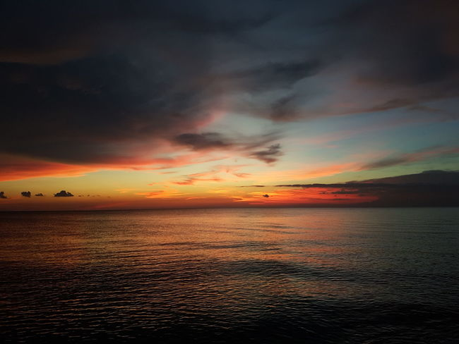 Sunset Sea Dramatic Sky Scenics Cloud - Sky Beauty In Nature Tranquility Idyllic No People Sky Outdoors Horizon Over Water Nature Water Beach