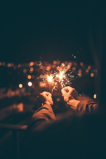 Close-up of hand holding sparklers