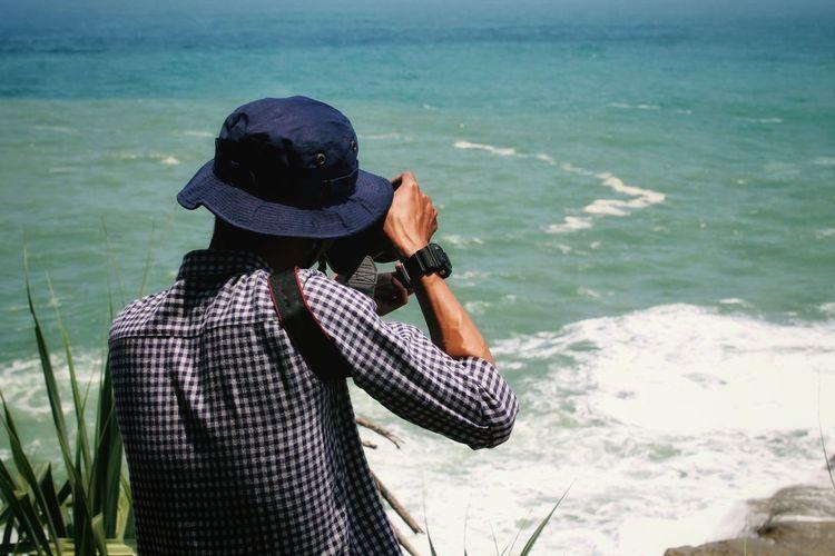 Man photographing sea