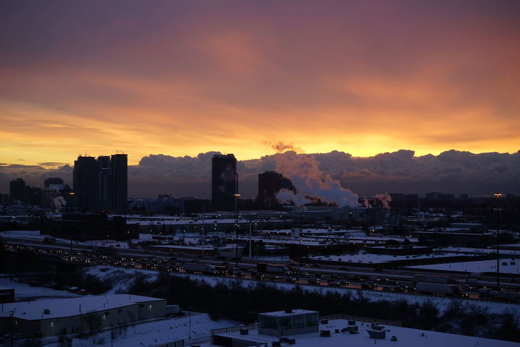 View Of Cityscape During Winter At Sunset