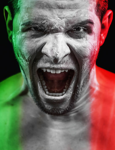 Forza Azzurri! Italia Italian Football Anger Black Background Close-up Front View Furious Human Face Looking At Camera Mouth Open Night One Person Outdoors People Portrait Real People Screaming Shouting Spooky Studio Shot