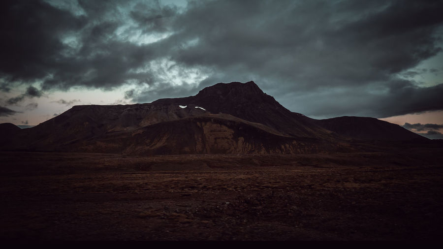 road iceland summer 24.00pm Cloud - Sky Sky Mountain Scenics - Nature Beauty In Nature Environment Storm Non-urban Scene Landscape Tranquil Scene No People Storm Cloud Nature Mountain Range Overcast Tranquility Land Idyllic Remote Outdoors Climate Mountain Peak Arid Climate Power In Nature Ominous Iceland