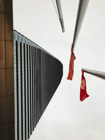 EyeEm Selects Hanging Day Flag No People Patriotism Outdoors Close-up Sky Skyscraper Skyrise