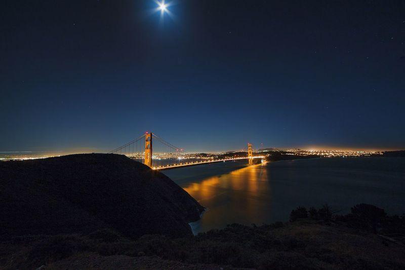 Illuminated golden gate bridge at night