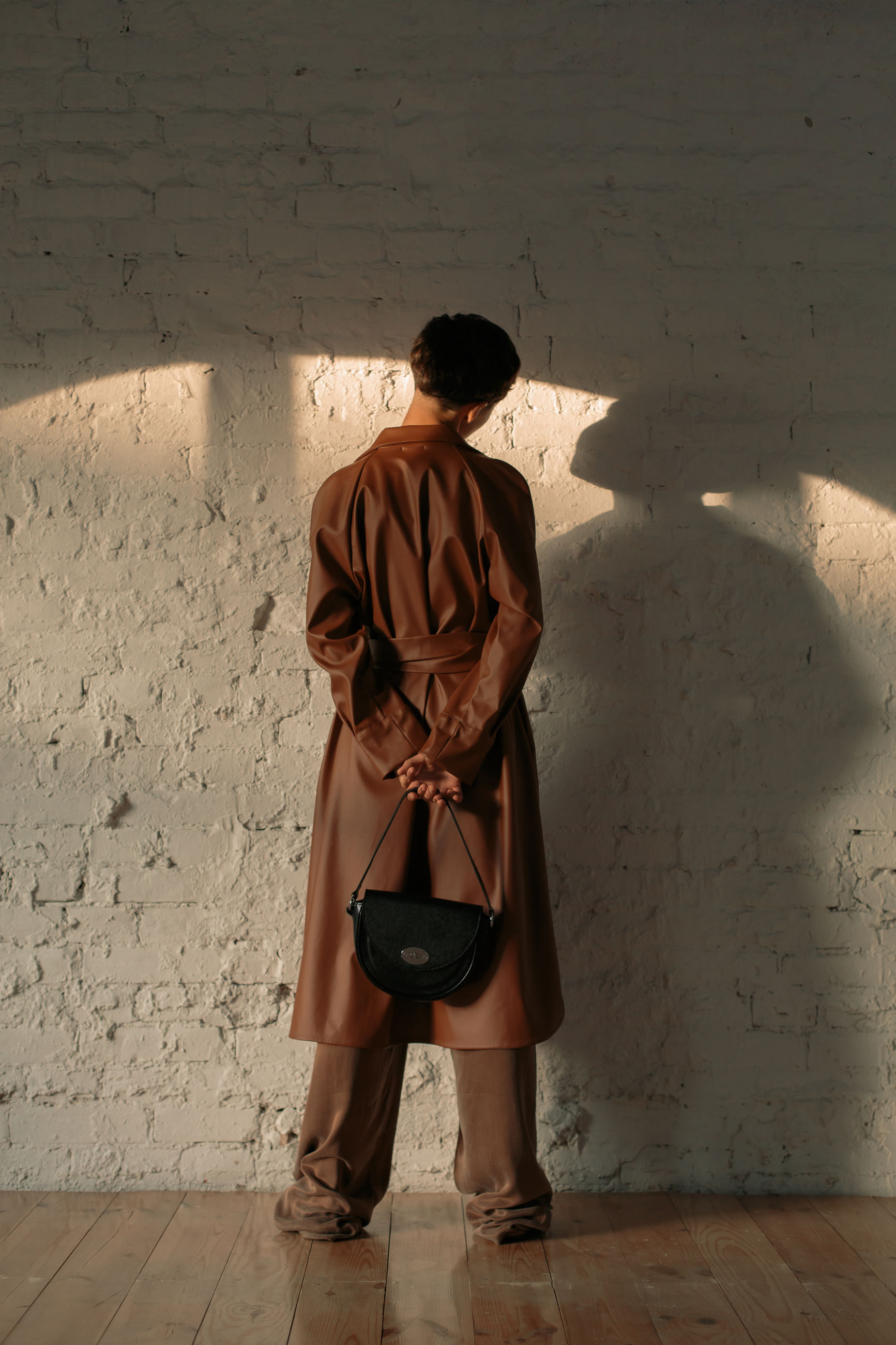 one person, real people, wall - building feature, full length, rear view, standing, men, architecture, indoors, lifestyles, sunlight, built structure, shadow, day, leisure activity, males, nature, clothing, casual clothing, contemplation