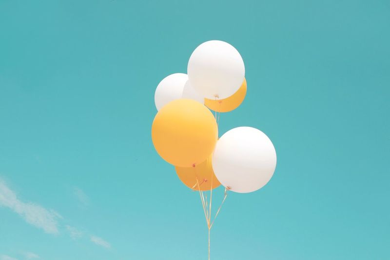 Beautiful Day Blue Sky Balloon Nature Sky Blue Yellow Outdoors Mid-air No People Celebration Orange Color Multi Colored Motion Fragility Colored Background Helium Balloon