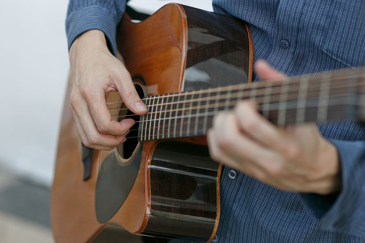 Playing guitar Human Hand Musician Plucking An Instrument Guitar Musical Instrument Young Women Classical Guitar Playing Music Arts Culture And Entertainment Acoustic Guitar Musical Instrument String Guitarist