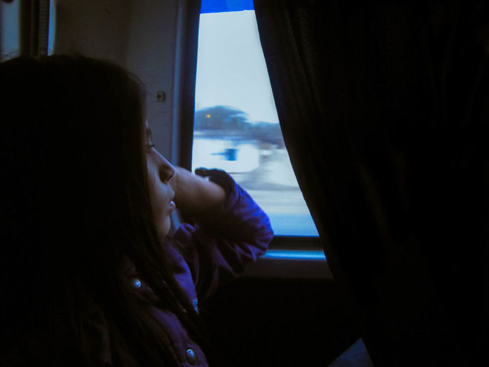 Thoughtful woman sitting in airplane