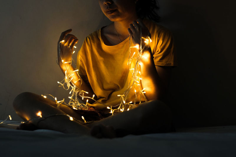 Midsection of woman with lighting