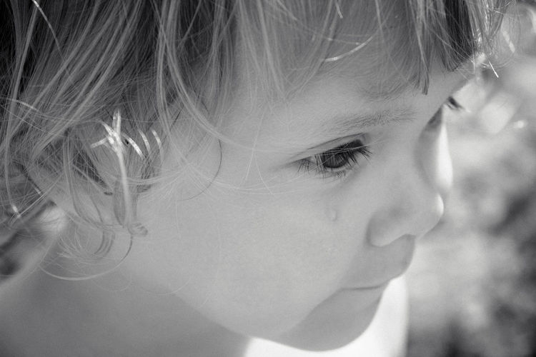 Close-up portrait of a girl looking away