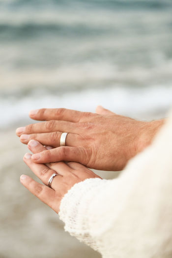 Cropped image of couple hands