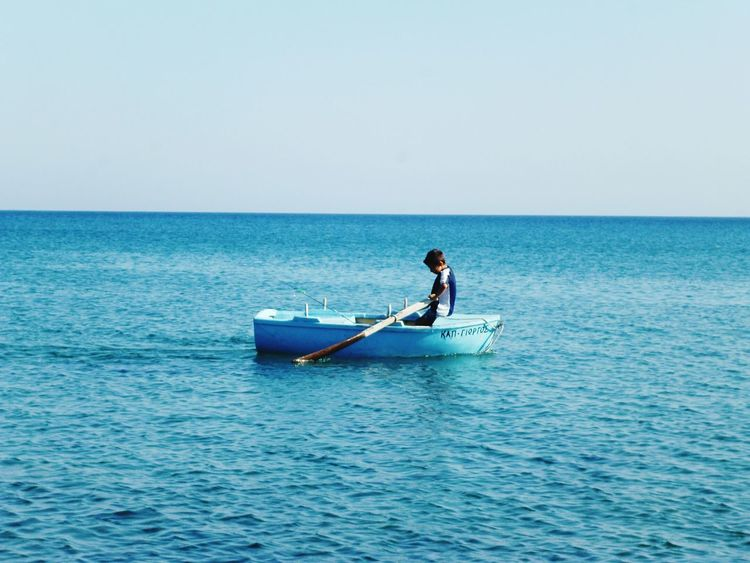 Greecesummer Greece Islands Sea Clear Sky Water Rowingboat Small Boat Small Boy Milos Island Blue Tranquil Water 3XSPUnity