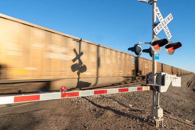 Railroad Crossing with a freight train passing by Rail Transportation Transportation Train Train - Vehicle Public Transportation Mode Of Transportation Railroad Crossing Railroad Track Railway Signal Track Blurred Motion Outdoors Crossing Sign The Week on EyeEm Texas United States