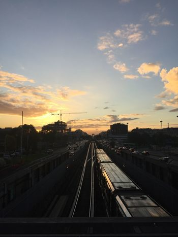 Transportation Sunset Sky Road No People Cloud - Sky Railroad Track Car Mode Of Transport Land Vehicle Built Structure Travel Rail Transportation Windshield Public Transportation Architecture City Travel Destinations Outdoors Nature