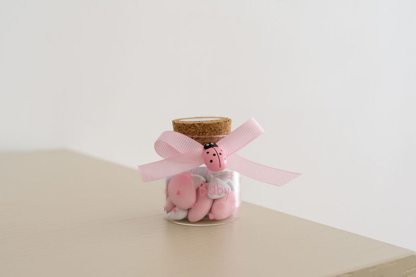Sugared almonds for christening day Sugared Almonds Almond Food And Drink Ladybug Pink Art And Craft Christening Day Close-up Copy Space Indoors  No People Pink Color Still Life Studio Shot Teddy Bear White