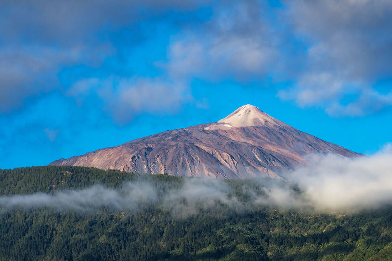 View of volcanic mountain against cloudy sky