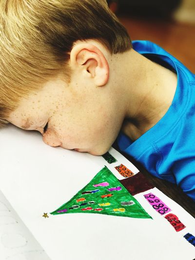 Kid falling asleep during artwork time Young Child Christmas Art Boy With Freckles Faceplant Child Asleep Falling Asleep Sleeping On The Job Childs Art Young Boy Leisure Activity One Person Indoors  Table Headshot Real People Close-up People Lifestyles