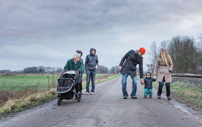 Family on road against sky