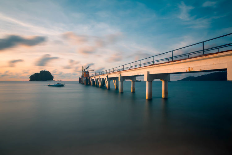Tioman Island beach Bridge Water Sea Sunset City Bridge - Man Made Structure Blue Reflection Sky Architecture Built Structure Horizon Footbridge
