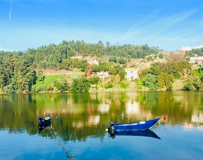 Gaia Douro River Portugal Rio Douro Avintes Water Reflection Architecture Building Exterior Lake Nature Built Structure Tree Beauty In Nature Blue Waterfront Transportation Scenics - Nature Day Sky
