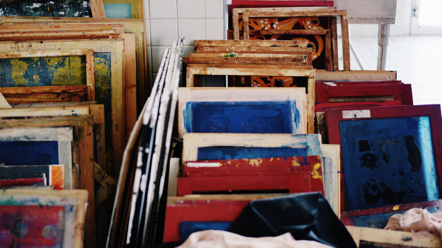 frame of painting Abandoned Absence Art Blue Box Business Choice Container Day Frame Furniture High Angle View Indoors  No People Old Paint Painting Paintings Retail  Seat Variation Watercolor Wood - Material