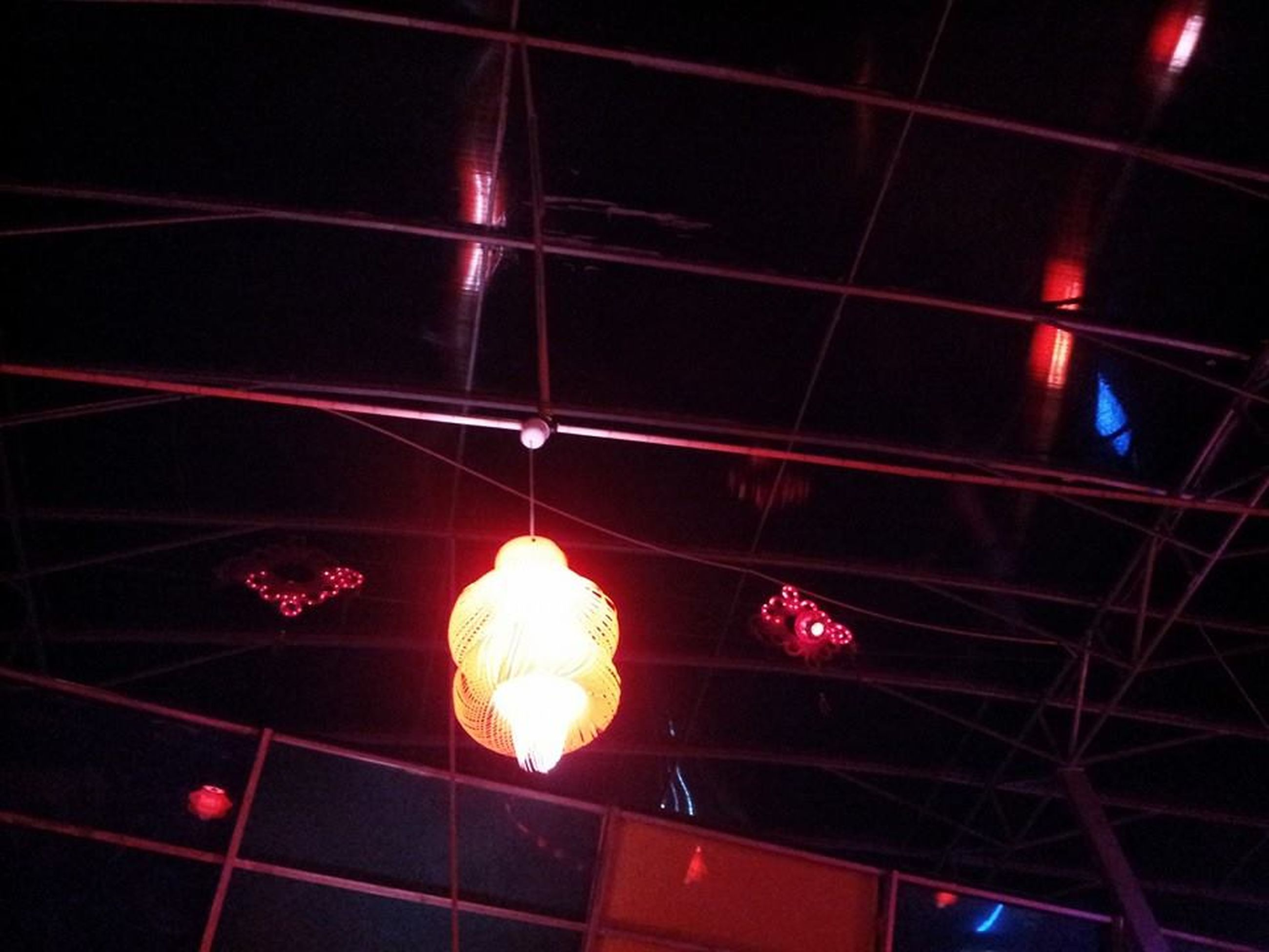 low angle view, hanging, ceiling, illuminated, decoration, lighting equipment, red, culture, glowing, party - social event, group of objects, power line, no people, multi colored