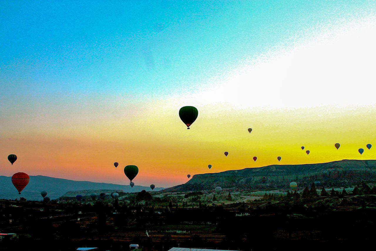 Low Angle View Hot Air Balloons Against Sky At Sunset