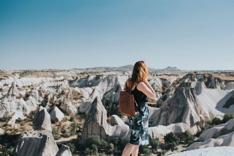 One Person Young Adult Beautiful Woman Hairstyle Young Women Environment Day Nature Cappadocia Alone Sightseeing Solo Rock Freedom Local Travel Outdoors Rock - Object Long Hair Copy Space Lifestyles Capture Tomorrow