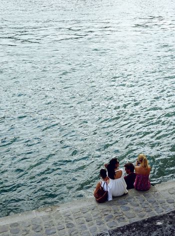 By the River Seine Carefree Casual Clothing Day Enjoyment Family Leisure Activity Nature Outdoors People Person Relaxation Resting Rippled River Seine Sitting Summer Togetherness Tourism Vacations Water Weekend Activities