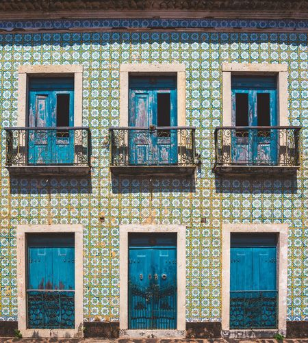 Exploring the ghost town of Alcantara. Architecture Blue Building Exterior Built Structure Colonial Colonial Architecture Day Door Frame Minimalism Minimalist Architecture No People Old Outdoors Retro Street Streetphotography Symmetry Tile Tiled Wall Travel Travel Photography Traveling Vintage Window The Street Photographer - 2017 EyeEm Awards The Architect - 2017 EyeEm Awards EyeEm Selects