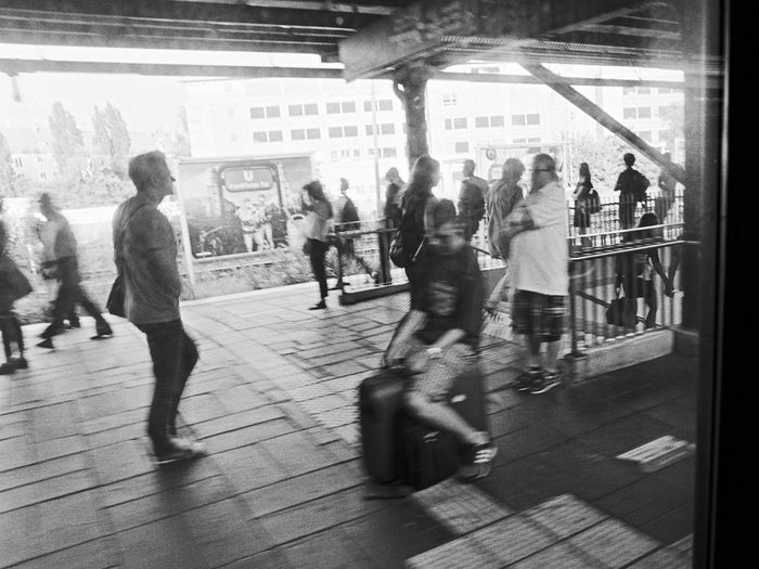 riding the wheeled suitcase... ;) Train Station Transportation 35mm Film Nikon FA Analogue Photography Black And White Schwarz & Weiß Monochrome Photography Berliner Ansichten Adults Only Architecture Blurred Motion Built Structure City City Life Crowd Day Full Length Large Group Of People Men People Real People Walking Women Young Adult