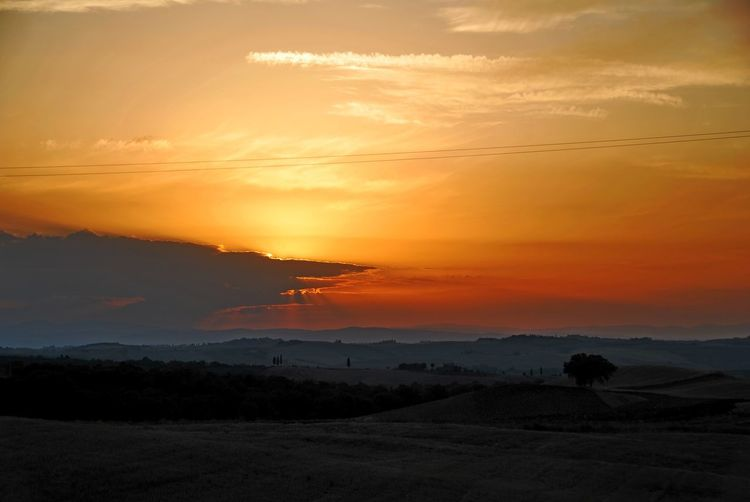 Montalcino. Beauty In Nature Cloud - Sky Day Landscape Mountain Nature One Person Orange Color Outdoors People Real People Scenics Silhouette Sky Sun Sunset Tranquil Scene Tranquility Tree