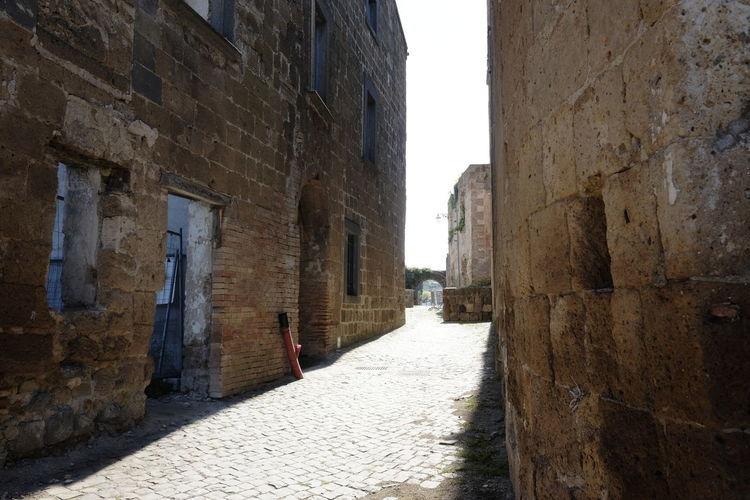ghost town Architecture Built Structure Building Exterior Direction The Way Forward Building City Day Old Alley Wall Footpath Walking Street Wall - Building Feature Narrow One Person History The Past Outdoors Stone Wall Ancient Civilization