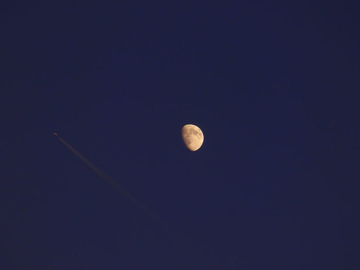 Airplane Flying Near The Moon Astronomy Beauty In Nature Circle Dark Discovery Idyllic Infinity Low Angle View Majestic Moon Moon Surface Nature Night No People Outdoors Planetary Moon Scenics Sky Space Space Exploration Sphere Tranquil Scene Tranquility