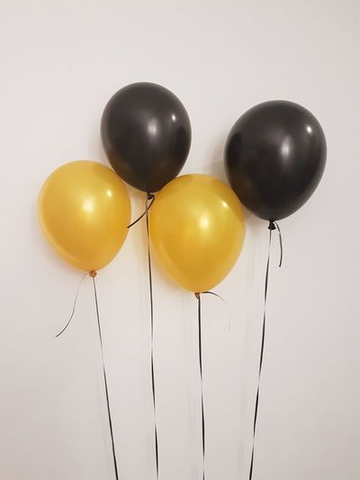 Yellow balloons against white background