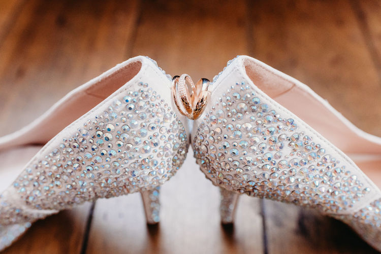 Close up of wedding shoes and rings