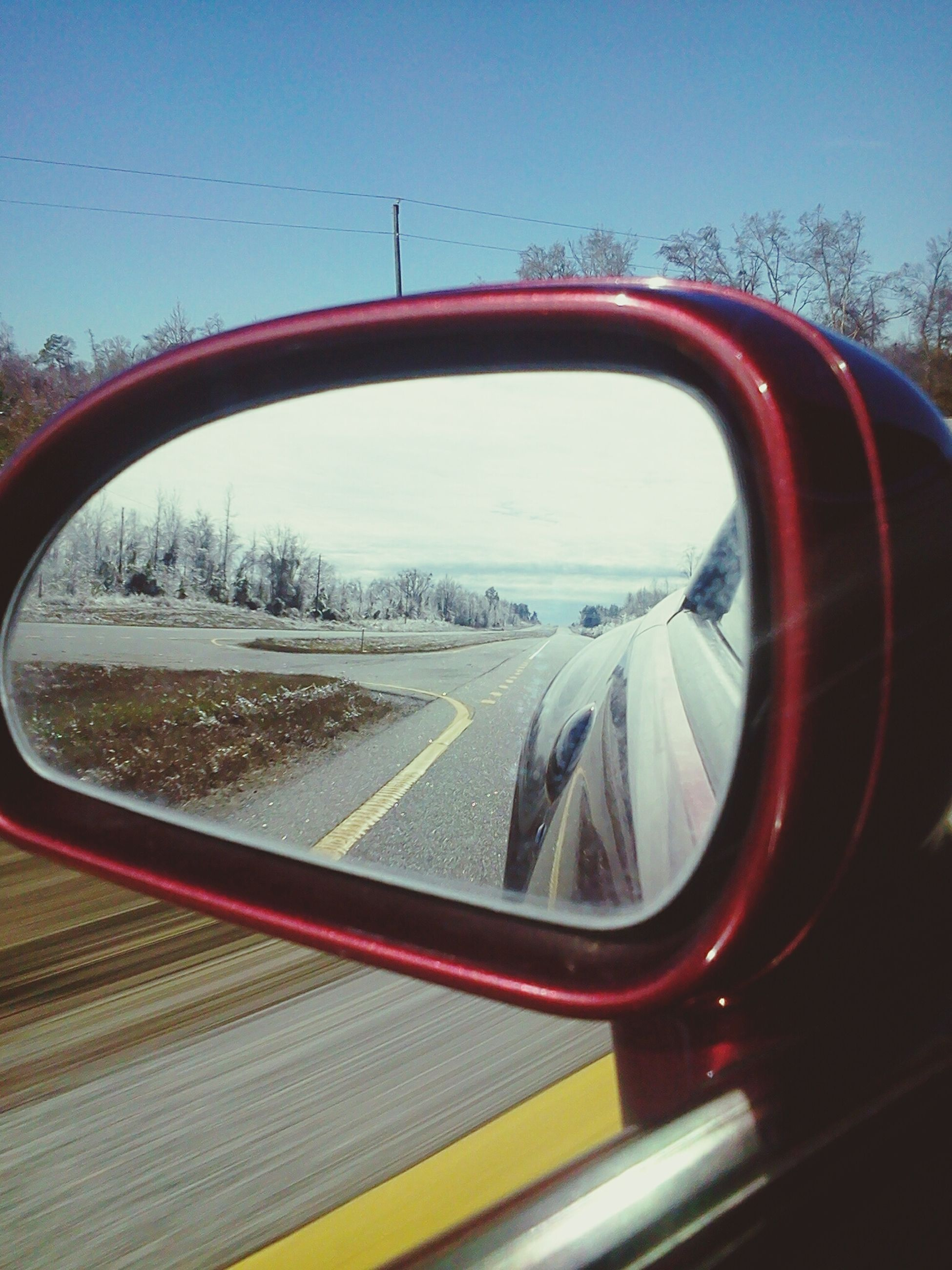 transportation, mode of transport, land vehicle, car, side-view mirror, vehicle interior, transparent, glass - material, car interior, road, reflection, travel, road trip, on the move, windshield, sky, part of, window, tree, rear view mirror
